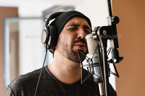 Young man singing with mic. - Stock Photo - Images