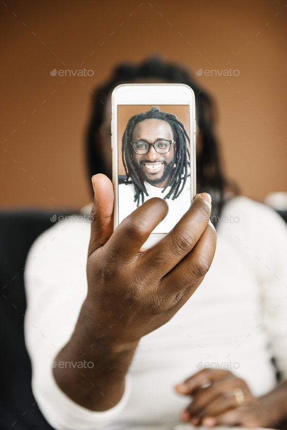 African man taking a selfie. - Stock Photo - Images