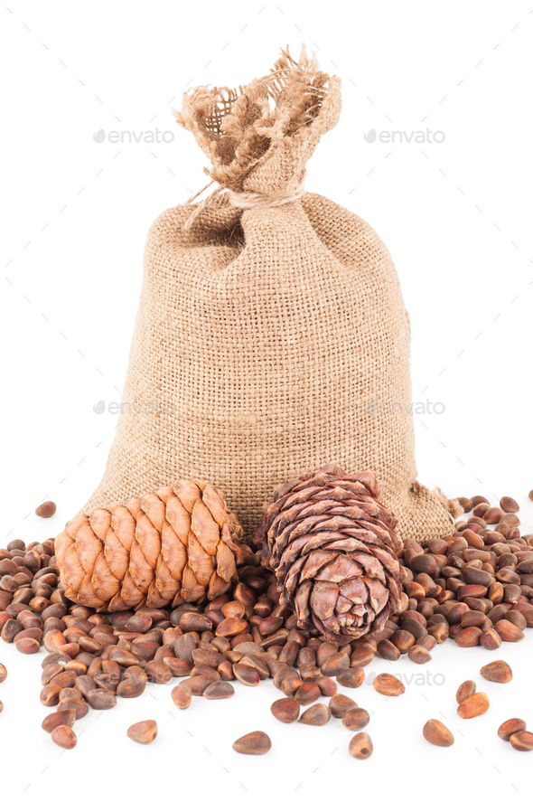 Pine nuts in a sackcloth bag - Stock Photo - Images