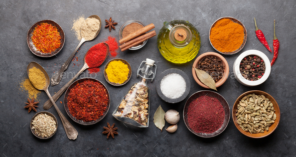 Various spices in bowls and spoons - Stock Photo - Images