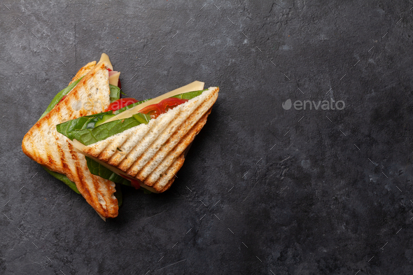 Club sandwich with ham, cheese, salad and vegetables - Stock Photo - Images