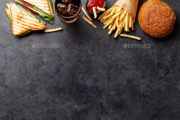 Club sandwich, potato fries, hamburger and cola - Stock Photo - Images
