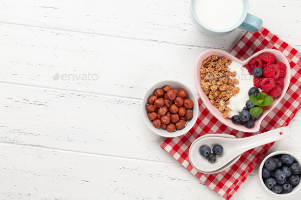 Healthy breakfast with granola, yogurt and berries - Stock Photo - Images