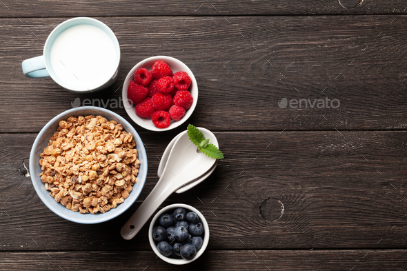 Healthy breakfast with granola and berries - Stock Photo - Images