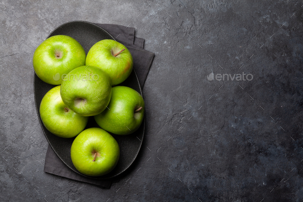 Ripe green apple fruits on dark stone table - Stock Photo - Images