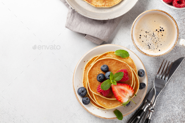 Delicious pancakes with berries and coffee - Stock Photo - Images
