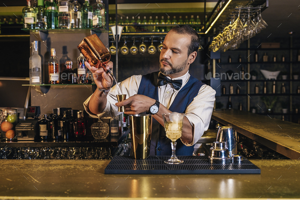 Barman is making cocktail at night club - Stock Photo - Images