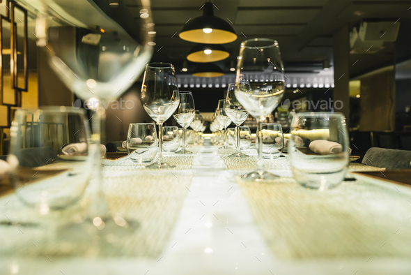 Wine glasses on a table in a restaurant - Stock Photo - Images