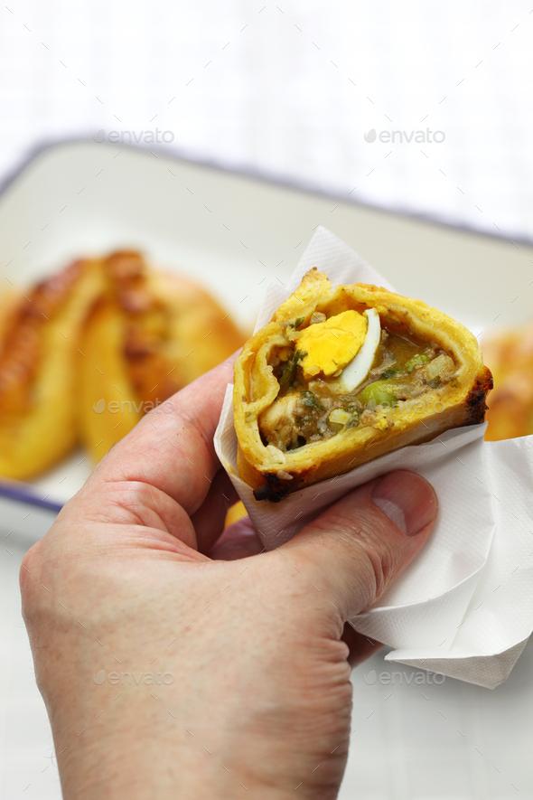 saltena, bolivian juicy filling empanada - Stock Photo - Images