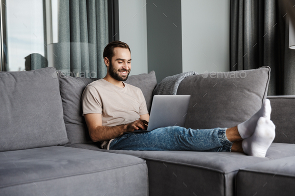 Happy positive young man indoors at home - Stock Photo - Images