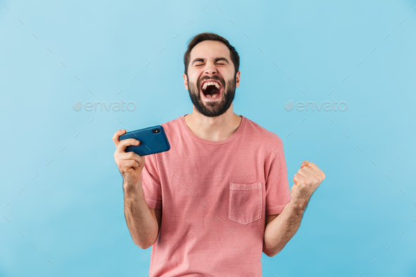 Happy man isolated over blue wall background - Stock Photo - Images