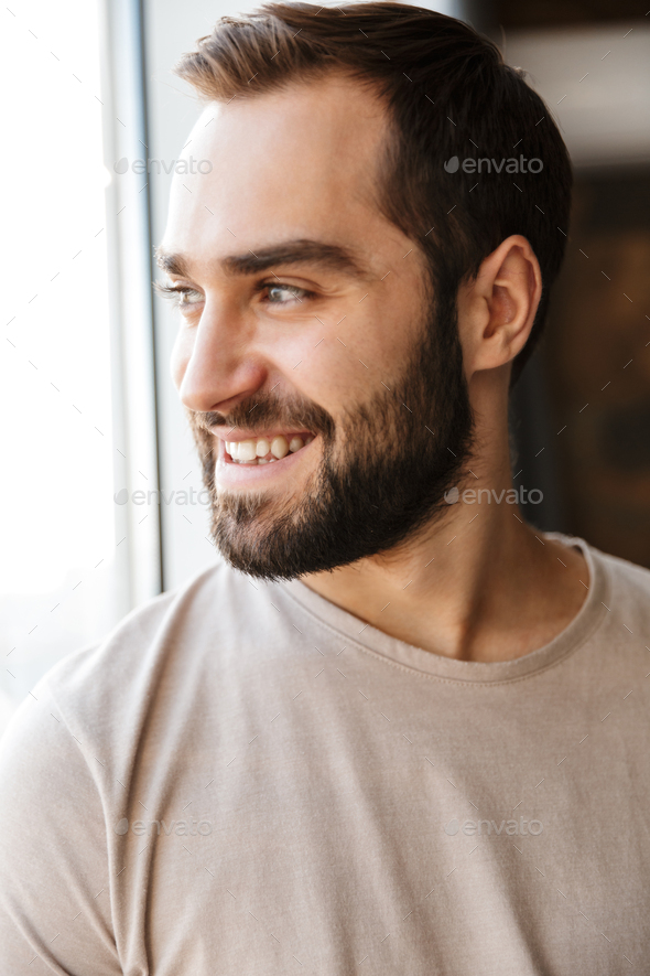 Handsome young bearded man - Stock Photo - Images