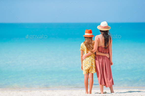 Beautiful mother and daughter on the beach - Stock Photo - Images