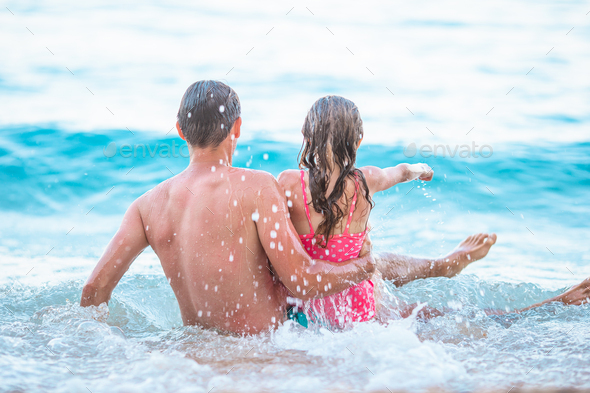 Father and his daughter enjoy beach vacation - Stock Photo - Images