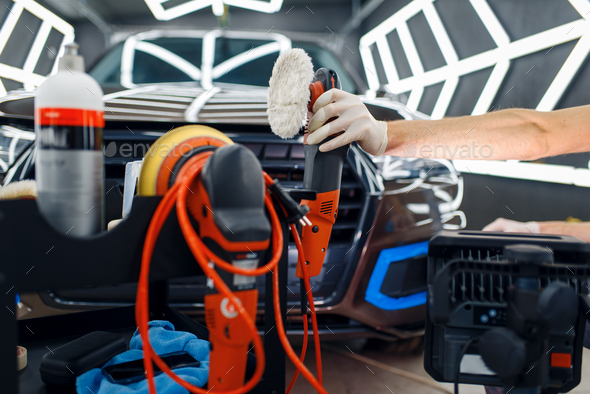 Worker, polishing machine and tools, car detailing - Stock Photo - Images