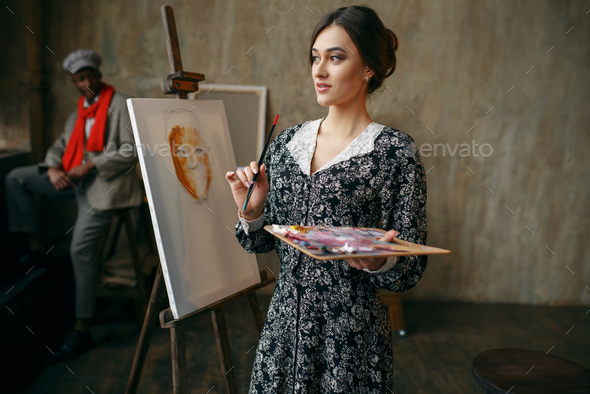 Female portrait painter and male model in studio - Stock Photo - Images