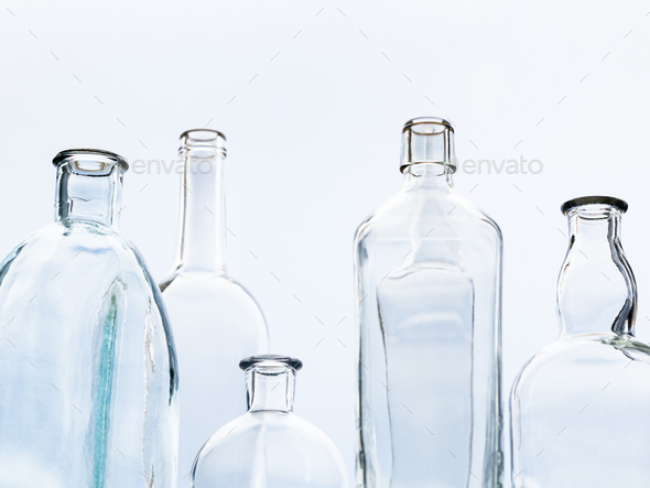 empty bottles and view of gray sky though window - Stock Photo - Images