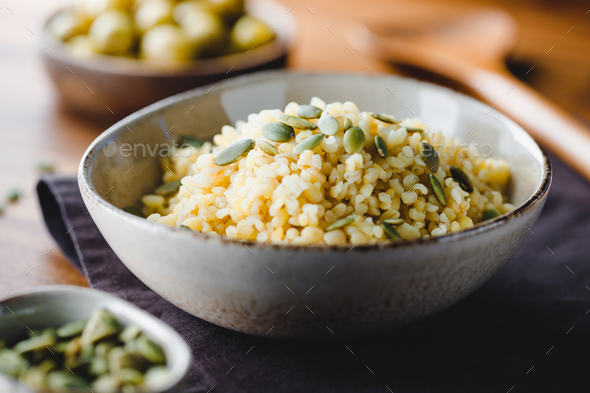 Bulgur with pepitas, healthy nutrition easy recipe from long-stored food. - Stock Photo - Images