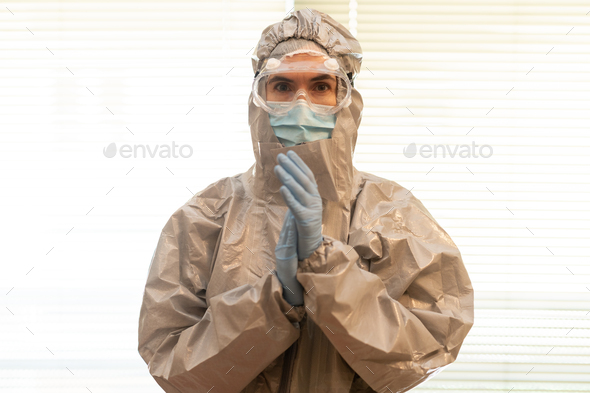 Female Doctor in PPE Personal Protective Equipment clap - Stock Photo - Images