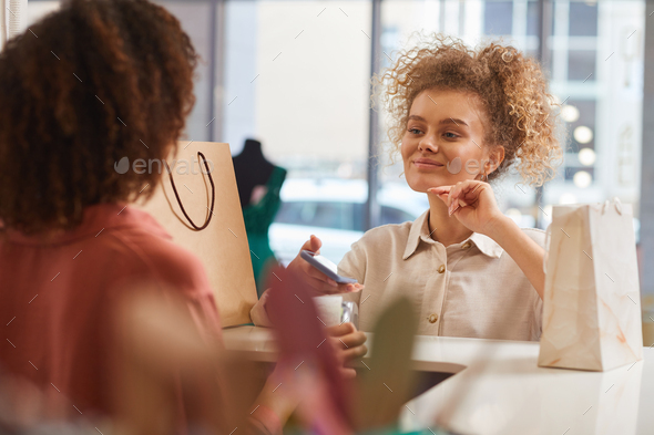 Young Woman Buying Clothes in Mall - Stock Photo - Images