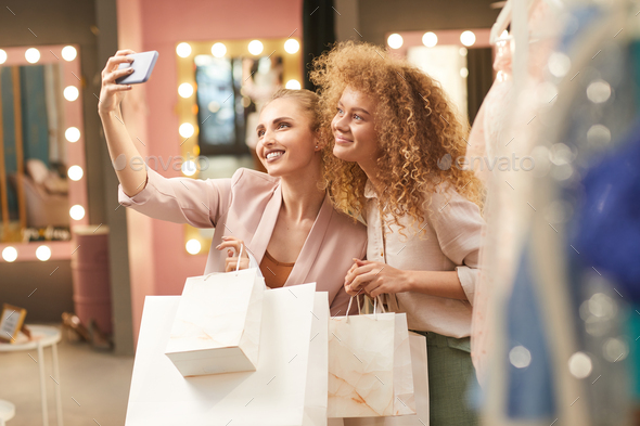 Two Young Women Taking Selfie in Boutique - Stock Photo - Images