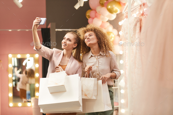 Two Young Women Taking Selfie in Mall - Stock Photo - Images