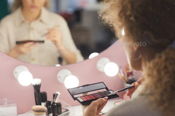 Young Woman Applying Makeup Close Up - Stock Photo - Images