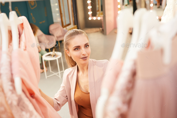 Elegant Woman Shopping in Clothing Store - Stock Photo - Images