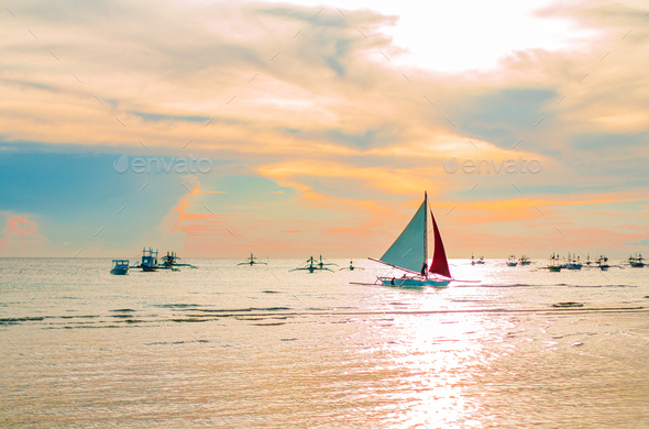 Sailing boat to the sunset in Boracay island - Stock Photo - Images