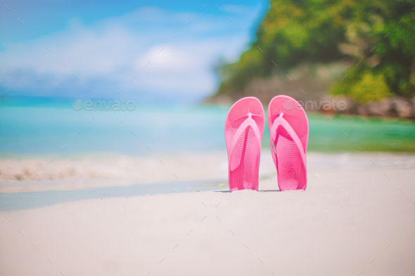 Colorful flipflop pair on the sea beach - Stock Photo - Images