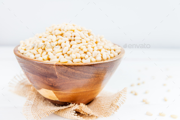 Shelled Raw Pine Nuts in the Wooden Bowl - Stock Photo - Images