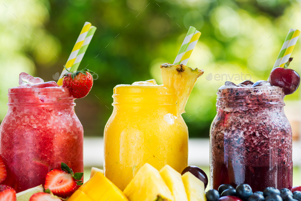 3 delicious slushies from different berries and fruits - Stock Photo - Images