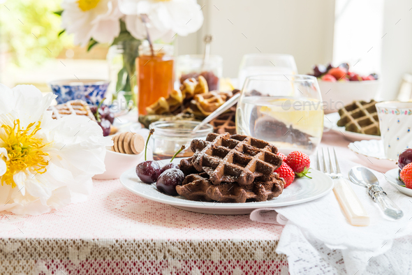Table Set for Breakfast with Waffles and Berries - Stock Photo - Images