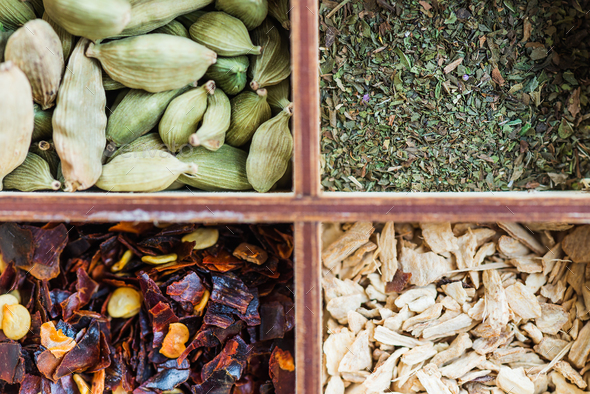 ginger, mint, clove, chili flakes, cardamon, star anise, cinnamo - Stock Photo - Images