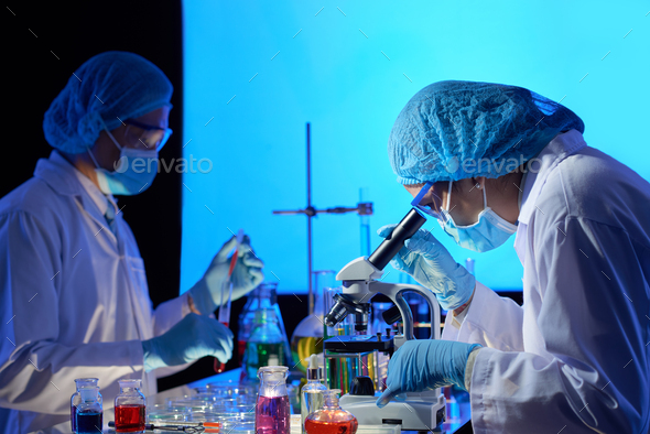 Scientists working on covid-19 vaccine - Stock Photo - Images