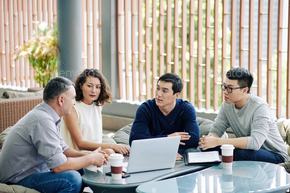 Coworkers discussing plan of project development - Stock Photo - Images