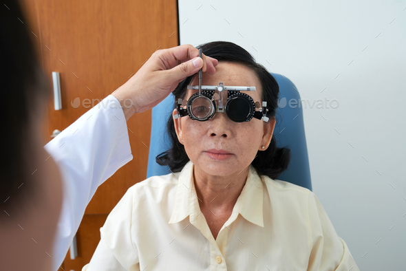 Doctor checking vision of patient - Stock Photo - Images