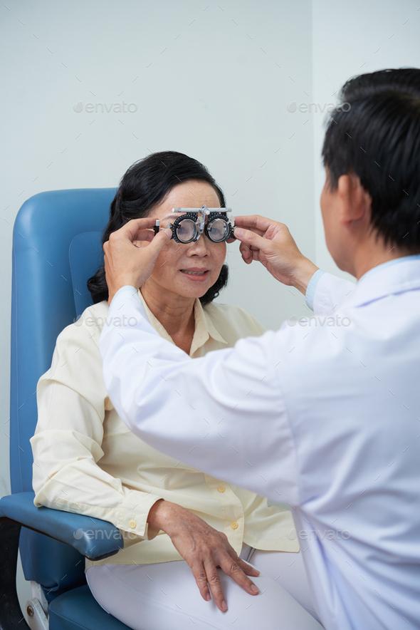 Ophthalmologist testing eyesight - Stock Photo - Images