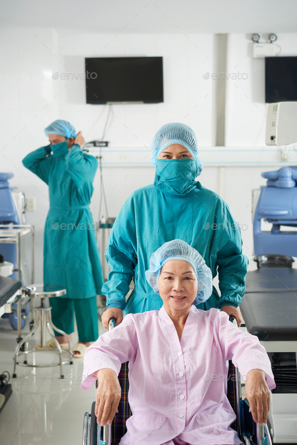 Patient in operating theater - Stock Photo - Images