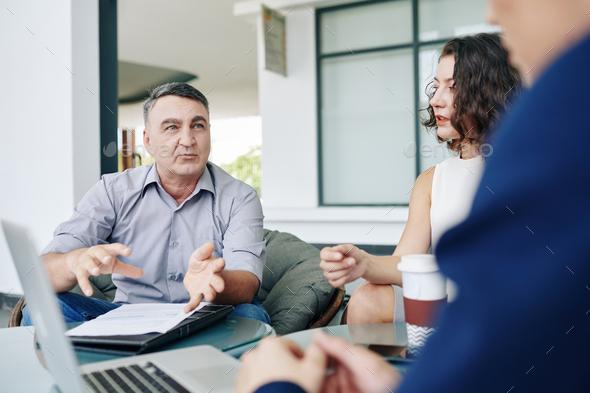 Entrepreneur talking to team - Stock Photo - Images