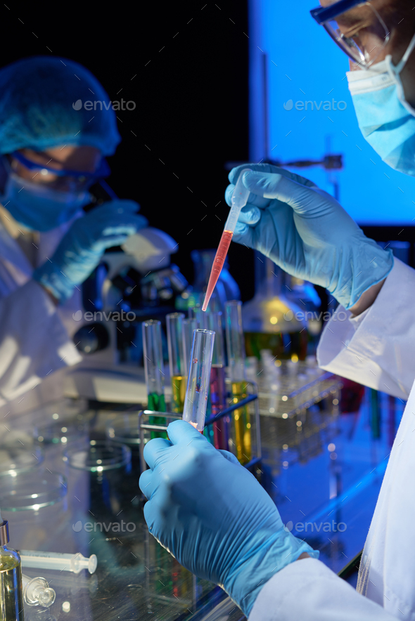 Laboratory technician working on vaccine - Stock Photo - Images