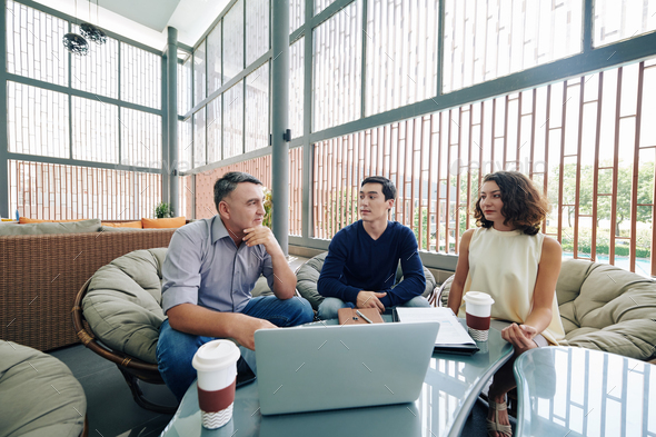 Managers meeting in office lounge area - Stock Photo - Images