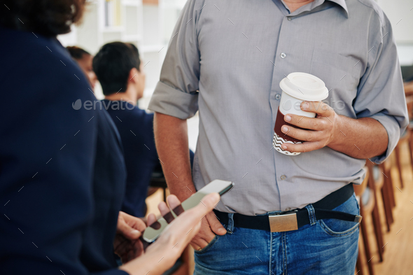 Business people talking during break - Stock Photo - Images