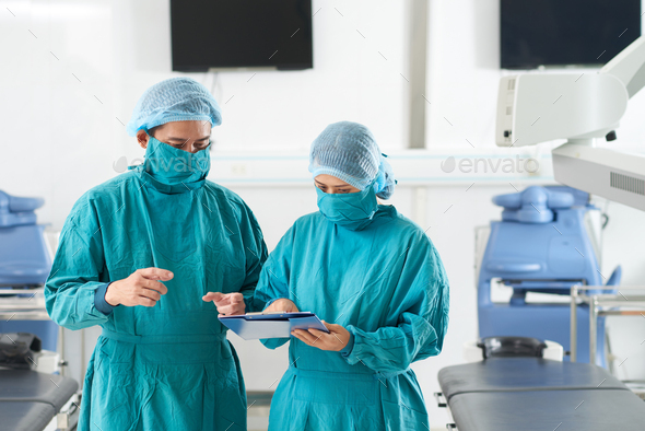 Surgeons discussing medical history - Stock Photo - Images