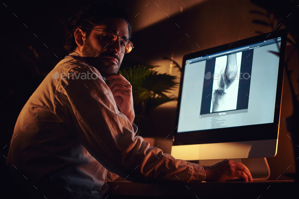 Doctor is working with a x-ray image - Stock Photo - Images