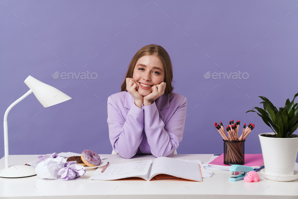 Optimistic young woman isolated over purple wall - Stock Photo - Images