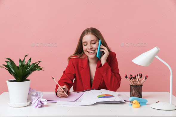 Woman sit at the table talking by mobile phone. - Stock Photo - Images