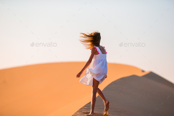 Girl among dunes in Rub al-Khali desert in United Arab Emirates - Stock Photo - Images