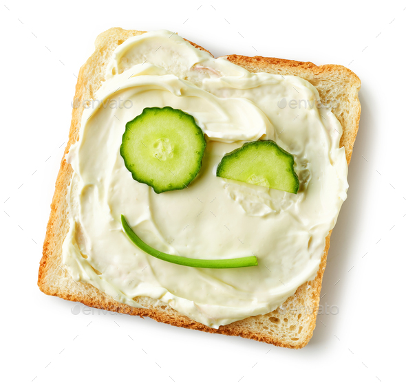 toasted bread with cream cheese and cucumber - Stock Photo - Images