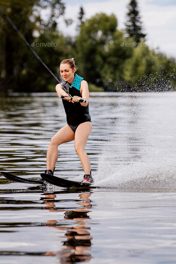 girl on water skiing - Stock Photo - Images